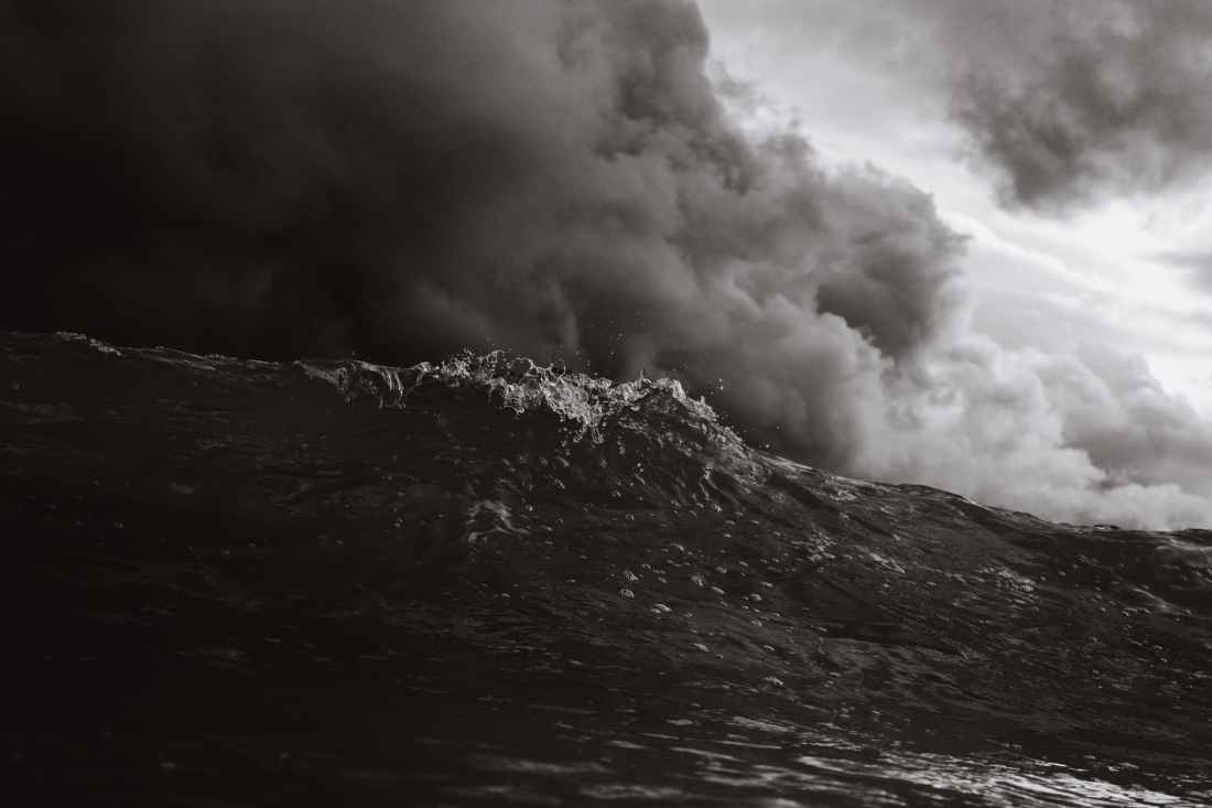 grayscale photo of body of waves